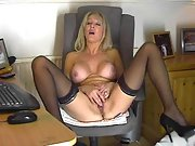 Busty mature light-haired strips and strokes on her cam