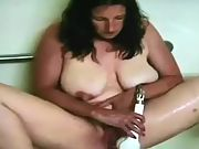 Wife with big natural hangers toying with the shower head 2