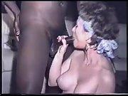 Ginormous titty milf worships a huge dark boner